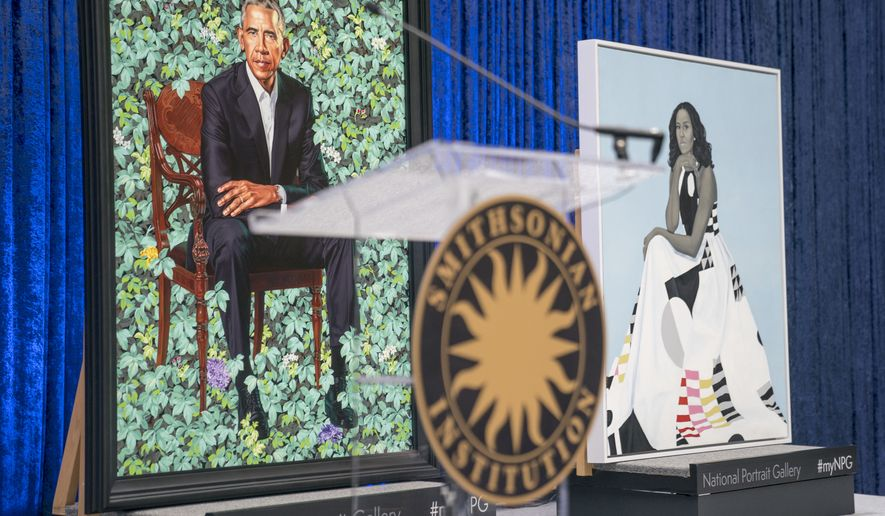 The official portraits of former President Barack Obama and former first lady Michelle Obama are displayed together following an official unveiling ceremony at the Smithsonian's National Portrait Gallery, Monday, Feb. 12, 2018, in Washington. Barack Obama's portrait was painted by artist Kehinde Wiley, and Michelle Obama's portrait was painted by artist Amy Sherald. (AP Photo/Andrew Harnik)