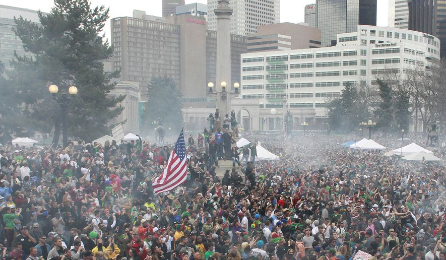 In this April 20, 2013 file photo, members of a crowd numbering tens of thousands smoke marijuana at the Denver 4/20 pro-marijuana rally at Civic Center Park in Denver. According to a report released on Monday, Feb. 12, 2018, the day marijuana users celebrate as their own holiday is linked with a slight increase in fatal U.S. car crashes, in an analysis of 25 years of data. Whether pot was involved in any April 20 crashes is not known, but the increased risk was similar in magnitude as found in previous research linking traffic accidents with Super Bowl Sunday. (AP Photo/Brennan Linsley, File)