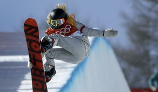 ChloeKim, of the United States, jumps during the women's halfpipe finals at Phoenix Snow Park at the 2018 Winter Olympics in Pyeongchang, South Korea, Tuesday, Feb. 13, 2018. (AP Photo/Gregory Bull)