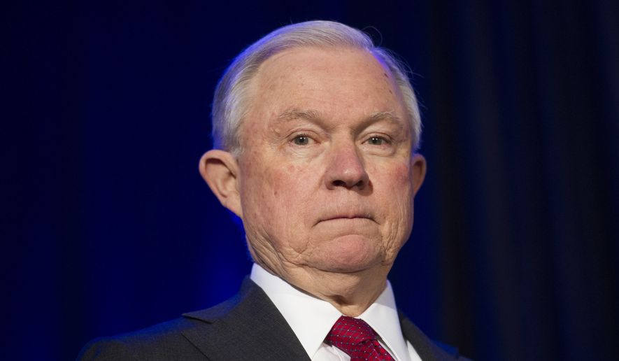 Attorney General Jeff Sessions is shown before addressing the National Sheriffs' Association Winter Conference on law enforcement efforts to combat the opioid crisis and violent crime, in Washington, Monday, Feb. 12, 2018. (AP Photo/Cliff Owen)