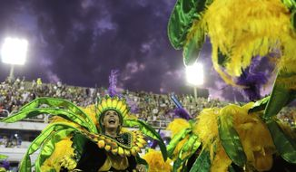 A performer from Mocidade samba school parades during Carnival celebrations at the Sambadrome in Rio de Janeiro, Brazil, Monday, Feb. 12, 2018. (AP Photo/Leo Correa)