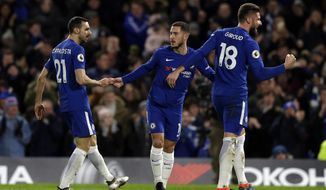 Chelsea's Eden Hazard, centre, celebrates after scoring the opening goal of the game during the English Premier League soccer match between Chelsea and West Bromwich Albion at Stamford Bridge stadium in London, Monday, Feb. 12, 2018. (AP Photo/Alastair Grant)
