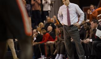 FILE - In this Jan. 20, 2018, file photo, Georgia head coach Mark Fox reacts as Auburn scores during the second half of an NCAA college basketball game, in Auburn, Ala. In an important season for coach Fox's future, Georgia has lost three straight and six of its last seven heading into Wednesday's game at Florida. The Bulldogs are running out of time to make the run for a NCAA Tournament appearance that may be needed to save Fox's job. (AP Photo/Albert Cesare, File)