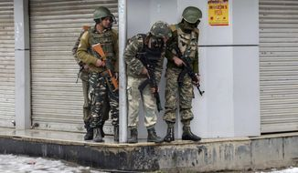 Indian paramilitary force soldiers take position at the site of a gunbattle with armed militants in Srinagar, Indian controlled Kashmir, Monday, Feb. 12, 2018. Officials say two gunmen have opened fire near a paramilitary camp in the main city of Indian controlled Kashmir killing at least one soldier. (AP Photo/Dar Yasin)