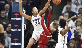 Connecticut's Napheesa Collier (24) blocks a shot by Louisville's Dana Evans (1) in the first half of an NCAA college basketball game Monday, Feb. 12, 2018, in Storrs, Conn. (AP Photo/Stephen Dunn)