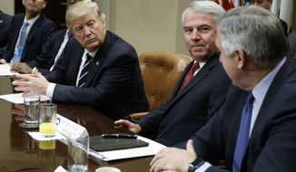 FILE - In this Jan. 31, 2017, file photo, President Donald Trump listens during a meeting with pharmaceutical executives including Celgene Corp.'s Executive Chairman Bob Hugin, second from right, in the Roosevelt Room of the White House in Washington. Hugin, who retired from the pharmaceutical firm on Monday, Feb. 5, 2018, announced in a Monday, Feb. 12, 2018, email he will challenge the re-election bid of U.S. Sen. Bob Menendez, D-N.J., by competing for the Republican nomination in New Jersey's Tuesday, June 5, 2018, primary against technology consultant Richard Pezzullo. (AP Photo/Evan Vucci, File)