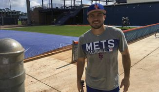 New York Mets baseball catcher Travis d'Arnaud poses for a photo in Port St. Lucie, Fla., Monday, Feb. 12, 2018. While the New York Mets focused on adding power and pitching this offseason, one problem area they didn't address was catcher. They're still counting on once-touted prospects Travis d'Arnaud and Kevin Plawecki _ or at least one of them _ to finally step forward and solidify that spot.(AP Photo/Mike Fitzpatrick)