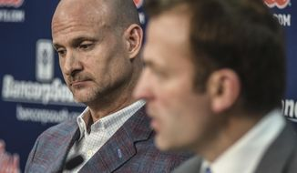Mississippi head coach Andy Kennedy, left, listens as athletic director Ross Bjork speaks at a press conference at the Pavilion at Ole Miss in Oxford, Miss. on Monday, February 12, 2018. Kennedy, in his 12th season as Mississippi head coach, announced he would not return as coach following this season.(Bruce Newman, Oxford Eagle via AP)