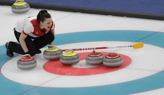 Switzerland Jenny Perret makes a call during the mixed doubles semi-final curling match against Russian athletes Anastasia Bryzgalova and Aleksandr Krushelnitckii at the 2018 Winter Olympics in Gangneung, South Korea, Monday, Feb. 12, 2018. (AP Photo/Natacha Pisarenko)