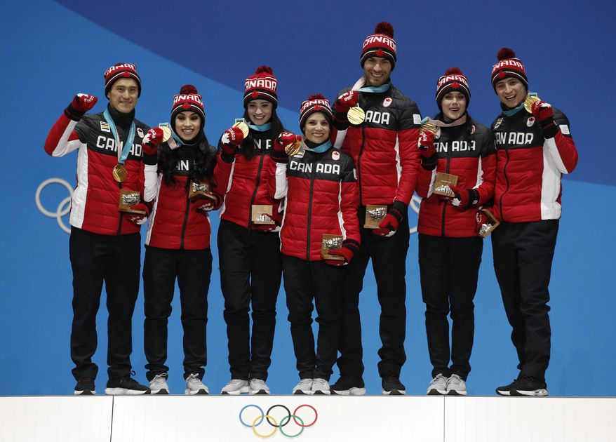 Team figure skating gold medalists from Canada pose during their medals ceremony at the 2018 Winter Olympics in Pyeongchang, South Korea, Monday, Feb. 12, 2018. (AP Photo/Jae C. Hong)