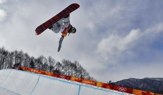 ChloeKim, of the United States, runs the course during the women's halfpipe qualifying at Phoenix Snow Park at the 2018 Winter Olympics in Pyeongchang, South Korea, Monday, Feb. 12, 2018. (AP Photo/Kin Cheung)