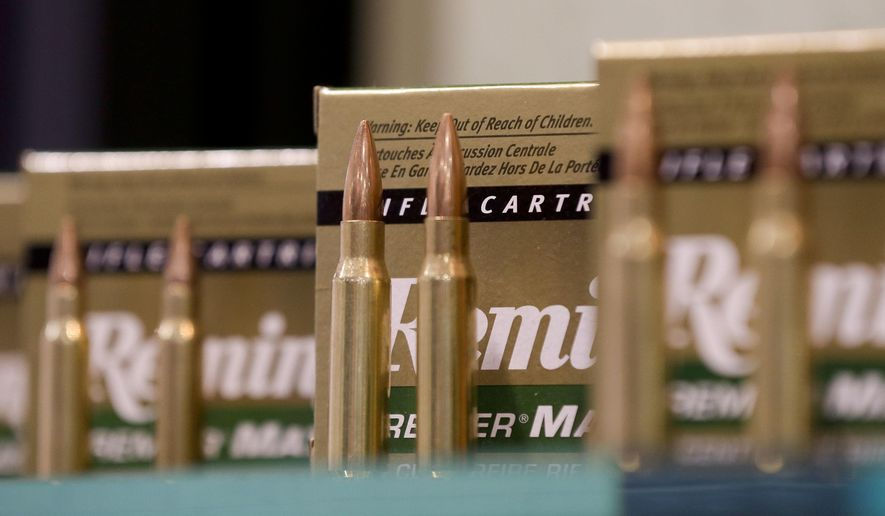 In this Jan. 15, 2013, file photo, Remington rifle cartridges are displayed at the 35th annual SHOT Show in Las Vegas. Remington, the gun maker beset by falling sales and lawsuits tied to the Sandy Hook Elementary School massacre, said Monday, Feb. 12, 2018, that it has reached a financing deal that would allow it to continue operating as it files for Chapter 11 bankruptcy protection. (AP Photo/Julie Jacobson, File)
