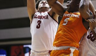 Alabama forward Alex Reese defends as Tennessee forward Admiral Schofield tries to shoot during the first half of an NCAA college basketball game Saturday, Feb. 10, 2018, in Tuscaloosa, Ala. (AP Photo/Brynn Anderson)