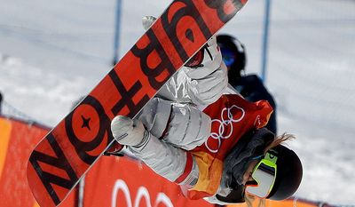 American Chloe Kim jumps en route to winning the gold medal during the women's halfpipe finals at the Winter Olympics in Pyeongchang, South Korea, on Tuesday. On her last run, Kim hit back-to-back 1,080-degree spins for a combination that no woman has ever competively performed. (ASSOCIATED PRESS PHOTOGRAPHS)