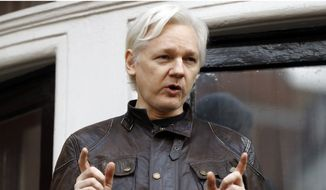 In this May 19, 2017, file photo, WikiLeaks founder Julian Assange gestures to supporters outside the Ecuadorian Embassy in London, where he has been in self imposed exile since 2012. (AP Photo/Frank Augstein, File)