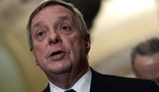 Sen. Dick Durbin, D-Ill., speaks to reporters on Capitol Hill in Washington, Tuesday, Feb. 13, 2018, following the weekly Democratic policy luncheon. (AP Photo/Susan Walsh) ** FILE **