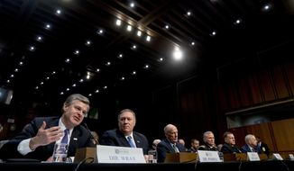From left, FBI Director Christopher Wray, accompanied by CIA Director Mike Pompeo, Director of National Intelligence Dan Coats, Defense Intelligence Agency Director Robert Ashley, National Security Agency Director Adm. Michael Rogers, and National Geospatial-Intelligence Agency Director Robert Cardillo, speaks at a Senate Select Committee on Intelligence hearing on worldwide threats, Tuesday, Feb. 13, 2018, in Washington. (AP Photo/Andrew Harnik)