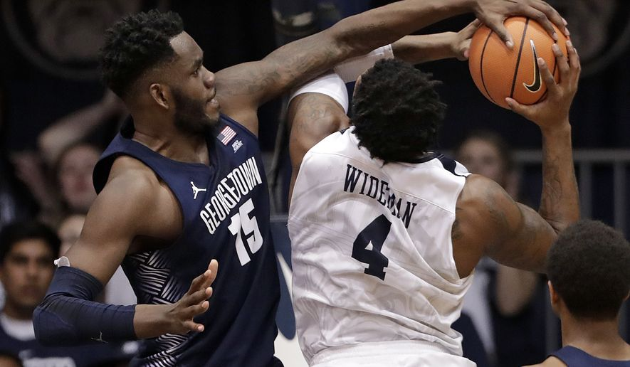 Georgetown center Jessie Govan (15) blocks the shot of Butler forward Tyler Wideman (4) during the second half of an NCAA college basketball game in Indianapolis, Tuesday, Feb. 13, 2018. Georgetown defeated Butler 87-83. (AP Photo/Michael Conroy)