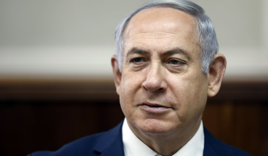 In this Sunday, Feb. 11, 2018, file photo, Israeli Prime Minister Benjamin Netanyahu chairs the weekly Cabinet meeting at the Prime Minister's office in Jerusalem. Israeli media reports Tuesday, Feb. 13, 2018 say police recommending Netanyahu indictment on corruption charges, including bribery. (Ronen Zvulun, Pool via AP, File)