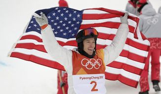 Shaun White, of the United States, celebrates winning gold after his run during the men's halfpipe finals at Phoenix Snow Park at the 2018 Winter Olympics in Pyeongchang, South Korea, Wednesday, Feb. 14, 2018. (AP Photo/Gregory Bull)