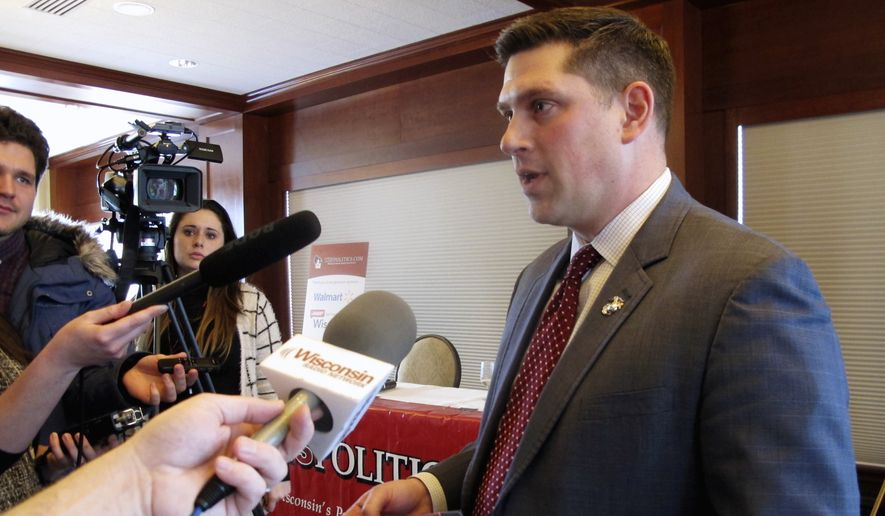 In this Jan. 30, 2018, file photo, Wisconsin Republican Senate candidate Kevin Nicholson speaks with reporters in Madison, Wis. Federal records show that Nicholsons parents have donated the maximum amount to the campaign of their son's Democratic rival, Sen. Tammy Baldwin. Nicholson is in a primary battle against Republican state Sen. Leah Vukmir, with the winner advancing to take on Baldwin in the fall. (AP Photo/Scott Bauer, File)