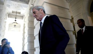 Special counsel Robert Mueller gave no indication about his next move with the indictments of 13 Russian operatives. (Associated Press/File) **FILE**