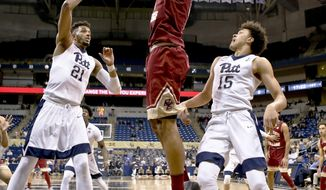Boston College's Steffon Mitchell, center, shoots between Pittsburgh's Terrell Brown (21) and Kene Chukwuka (15) during the first half of an NCAA college basketball game, Tuesday, Feb. 13, 2018, in Pittsburgh. (AP Photo/Keith Srakocic)