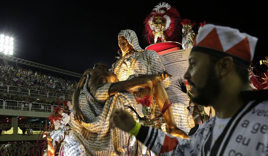 Performers from the Salgueiro samba school parade on a float during Carnival celebrations at the Sambadrome in Rio de Janeiro, Brazil, early Tuesday, Feb. 13, 2018. (AP Photo/Silvia Izquierdo)