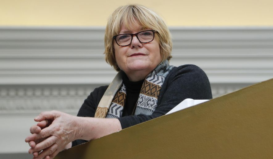 """Writer Bridget Lawless poses for photographs in London, Friday, Feb. 9, 2018.  Lawless is so sick of the violence that she has set up a book prize to reward crime novels """"in which no woman is beaten, stalked, sexually exploited, raped or murdered."""" The contest has some writers and readers cheering, but others say it could deter authors from tackling tough issues. (AP Photo/Frank Augstein)"""