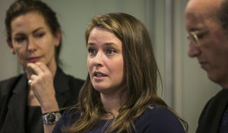Alaina Hampton, a campaign worker for Illinois Democrats speaks during a news conference, Feb. 13, 2018 in Chicago accompanied by advocates Lorna Brett, left and Shelly Kulwin. Hampton addressed reporters a day after House Speaker Michael Madigan dismissed political consultant Kevin Quinn after an investigation found Quinn sent her inappropriate text messages. Hampton asked Kevin Quinn several times to stop asking her out and sending suggestive texts, which started in 2016. She reported the behavior in February 2017 to Quinn's supervisor. In November, she wrote Madigan who had an attorney investigate. (Ashlee Rezin/Chicago Sun-Times via AP)