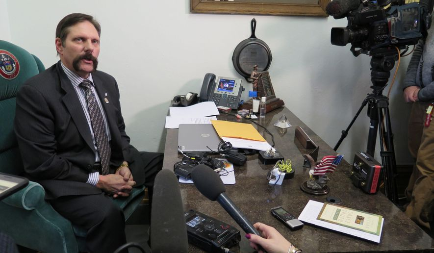 Republican State Sen. Randy Baumgardner speaks to the media regarding sexual misconduct allegations that he denies, Tuesday, Feb. 13, 2018, in Denver. Baumgardner said Tuesday that he was voluntarily giving up the chairmanship of the Senate's Transportation Committee and would attend sensitivity training. (AP Photo/Colleen Slevin)