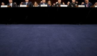 From left, FBI Director Christopher Wray, CIA Director Mike Pompeo, Director of National Intelligence Dan Coats, Defense Intelligence Agency Director Robert Ashley, National Security Agency Director Adm. Michael Rogers, and National Geospatial-Intelligence Agency Director Robert Cardillo, appear before a Senate Select Committee on Intelligence hearing on worldwide threats, Tuesday, Feb. 13, 2018, in Washington. (AP Photo/Andrew Harnik)
