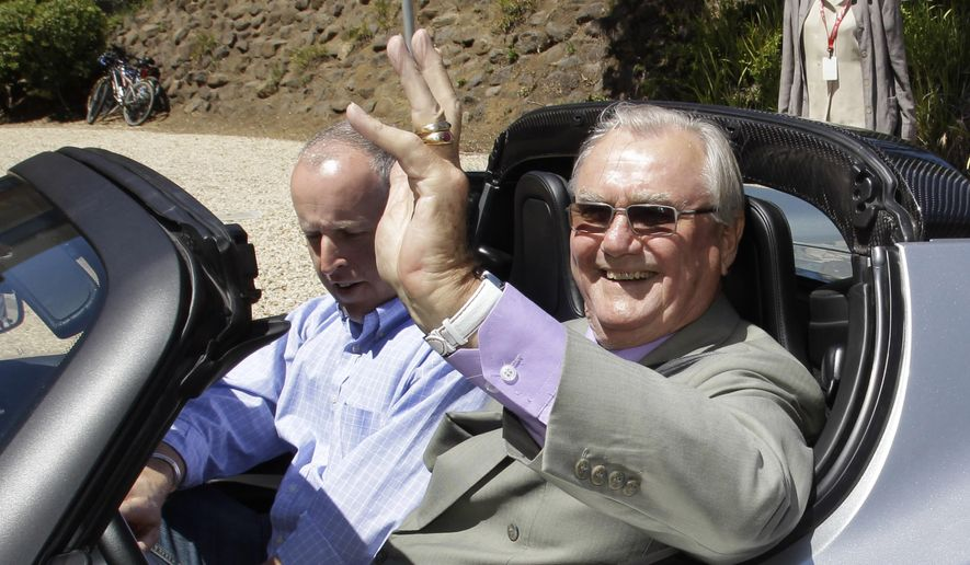"In this June 13, 2011, file photo, Denmark's Prince Henrik, right, waves as he drives a Tesla Roadster at the electric car maker's headquarters in Palo Alto, Calif. Denmark's royal palace says the 83-year-old Prince Henrik, has been transferred from a Copenhagen hospital to the family's residence north of the capital ""where he wishes to spend his last moments."" (AP Photo/Paul Sakuma, File)"