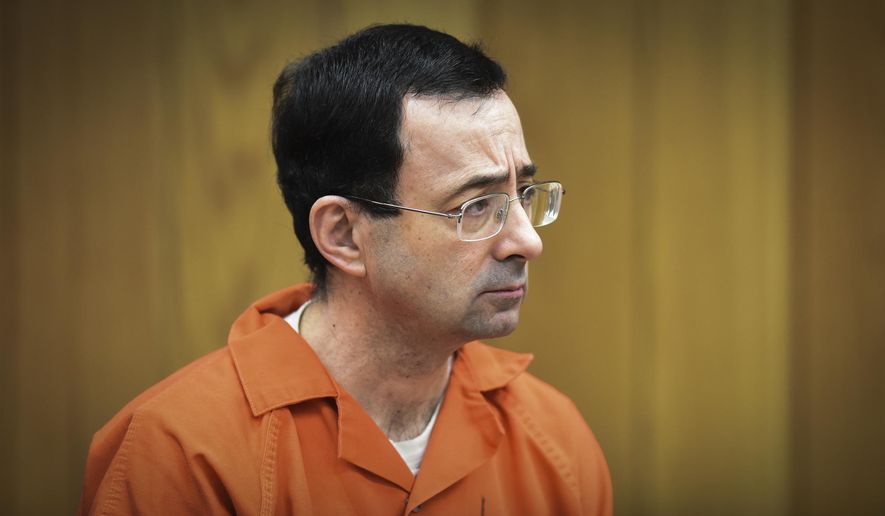 FILE - In this Feb. 5, 2018 file photo, Larry Nassar, former sports doctor who admitted molesting some of the nation's top gymnasts, appears in Eaton County Court in Charlotte, Mich. USA Gymnastics, the U.S. Olympic Committee and Michigan State University have responded to initial inquiries from Congress regarding their handling of the Larry Nassar sexual abuse scandal. A Senate subcommittee with jurisdiction over the health and safety of athletes made the institutions' answers public on Tuesday, Feb. 13, 2018. (Matthew Dae Smith/Lansing State Journal via AP, File)