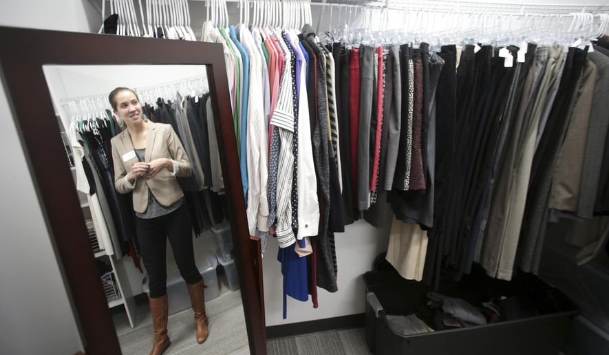 ADVANCE FOR WEEKEND EDITIONS, FEB 17-18 - In this Wednesday, Feb. 7, 2018 photo,  Emily Keepman shows off the career closet where student can borrow clothes for interviews at SuccessWorks on the University of Wisconsin-Madison campus held a grand opening reception in Madison, Wis. (Steve Apps/Wisconsin State Journal via AP)