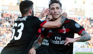 AC Milan's Luca Biglia, right, celebrates with teammates after scoring his side's third goal, during the Serie A soccer match between Spal and AC Milan at the Paolo Mazza Stadium in Ferrara,Italy, Saturday, Feb. 10, 2018. (Serena Campanini/ANSA via AP)
