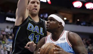 Dallas Mavericks forward Dirk Nowitzki (41) of Germany defends as Sacramento Kings forward Zach Randolph (50) works for a shot in the first half of an NBA basketball game Tuesday, Feb. 13, 2018, in Dallas. (AP Photo/Tony Gutierrez)
