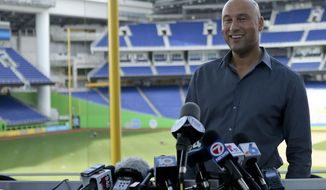Miami Marlins baseball team CEO Derek Jeter talks with the media during a press conference at Marlins Park in Miami, Tuesday, Feb. 13, 2018. (David Santiago/Miami Herald via AP)