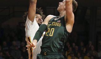 Michigan State's Matt McQuaid, right, shoots as Minnesota's Jordan Murphy defends during the first half of an NCAA college basketball game Tuesday, Feb. 13, 2018, in Minneapolis. (AP Photo/Jim Mone)