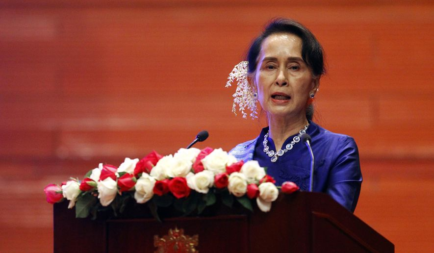 """Myanmar's leader Aung San Suu Kyi speaks during the signing ceremony of """"Nationwide Ceasefire Agreement"""" at Myanmar International Convention Center in Naypyitaw, Myanmar, Tuesday, Feb. 13, 2018. (AP Photo/Aung Shine Oo)"""