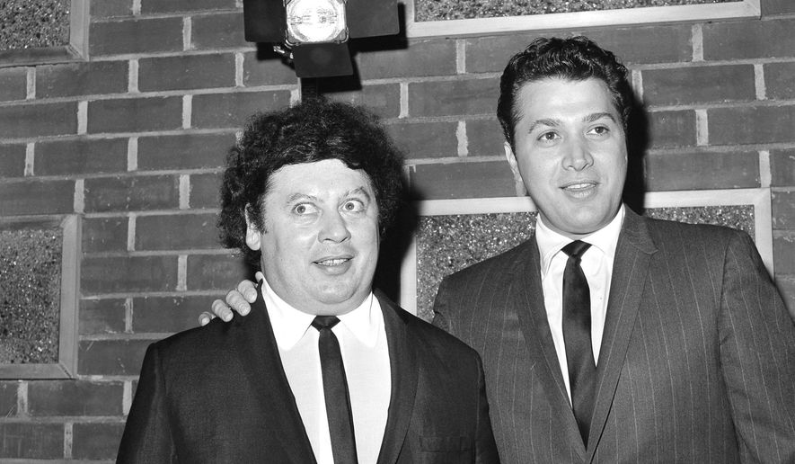 In this Dec. 10, 1965, file photo, the comedy team of Marty Allen, left, and Steve Rossi, now making their first film on the Paramount lot in Los Angeles. Allen's spokeswoman Candi Cazau says he died Monday, Feb. 12, 2018, of complications from pneumonia. His wife and performing partner Karon Kate Blackwell was by his side. He was 95. (AP Photo/David F. Smith, File)