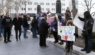 Students, teachers and other supporters of the Electronic Classroom of Tomorrow rally outside the Ohio Supreme Court, Tuesday, Feb. 13, 2018, in Columbus, Ohio, as the court hears arguments in ECOT's legal dispute with the state. The now-closed e-school has challenged how state officials tallied student enrollment and participation to determine ECOT should repay tens of millions of dollars. (AP Photo/Kantele Franko)