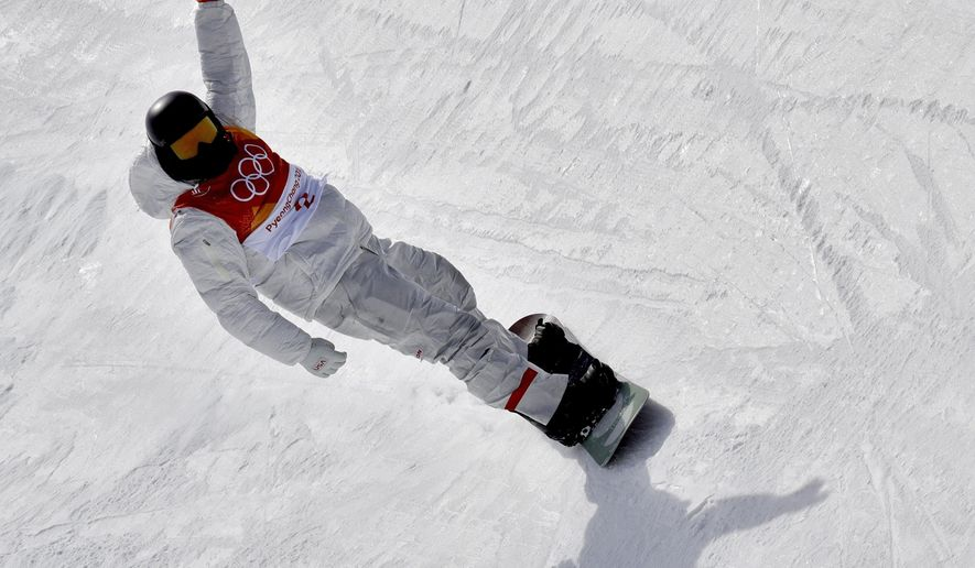 Shaun White, of the United States, finishes his run during the men's halfpipe qualifying at Phoenix Snow Park at the 2018 Winter Olympics in Pyeongchang, South Korea, Tuesday, Feb. 13, 2018. (AP Photo/Lee Jin-man)