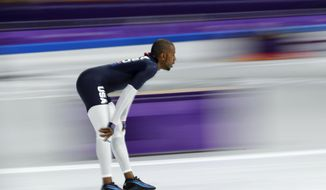 Shani Davis if the U.S. rides warm-up laps prior to the men's 1,500 meters speedskating race at the Gangneung Oval at the 2018 Winter Olympics in Gangneung, South Korea, Tuesday, Feb. 13, 2018. (AP Photo/John Locher)