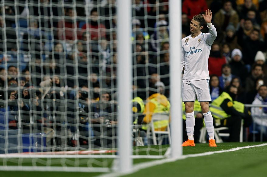Real Madrid's Cristiano Ronaldo gestures during a Spanish La Liga soccer match between Real Madrid and Real Sociedad at the Santiago Bernabeu stadium in Madrid, Saturday, Feb. 10, 2018. Ronaldo scored a hat-trick in Real Madrid's 5-2 victory. (AP Photo/Francisco Seco)