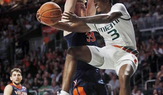 Miami guard Anthony Lawrence II (3) goes up for a shot against Virginia center Jack Salt (33) during the first half of an NCAA college basketball game, Tuesday, Feb. 13, 2018, in Coral Gables, Fla. (AP Photo/Wilfredo Lee)