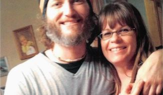 "This undated photo provided by attorney Pressley Henningsen, shows Bronson Ganka and his wife, Kara, shortly before he died in 2014 after falling from a ladder while working in Iowa City, Iowa. Ganka's supervisor was ordered to pay $5.6 million Tuesday, Feb. 13, 2018, after a jury found that he was responsible for ""gross negligence"" in safety lapses that caused Ganka's death. (Kara Ganka/Pressely Henningsen via AP)"