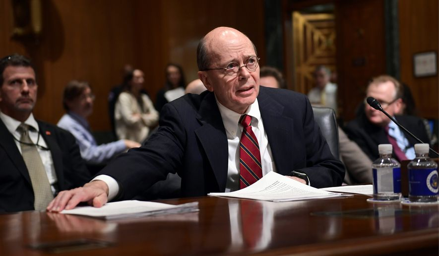 """IRS Acting Commissioner David Kautter says the agency needs $397 million over next two years to implement the tax cut law. It's """"critical"""" he said. gathers his papers as he prepares to testify before the Senate Finance Committee on Capitol Hill in Washington, Wednesday, Feb. 14, 2018, on President Donald Trump's fiscal year 2019 budget proposal. (AP Photo/Susan Walsh) (Associated Press)"""