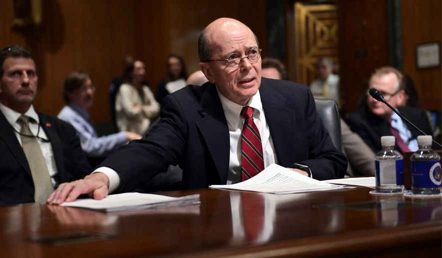 Internal Revenue Service Acting Commissioner David Kautter gathers his papers as he prepares to testify before the Senate Finance Committee on Capitol Hill in Washington, Wednesday, Feb. 14, 2018, on President Donald Trump's fiscal year 2019 budget proposal. (AP Photo/Susan Walsh) ** FILE **