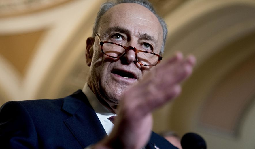 Senate Minority Leader Sen. Chuck Schumer of N.Y., speaks to reporters following a Senate policy luncheon on Capitol Hill in Washington, Tuesday, Jan. 23, 2018. (AP Photo/Andrew Harnik)